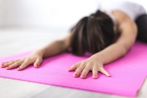 Woman Exercising On A Yoga Mat